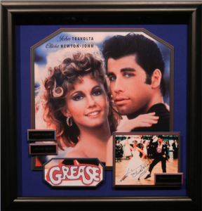 "John Travolta and Olivia Newton-John Dual Signed ""Grease"" Masterpiece Collage"