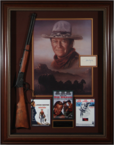 John Wayne Hand Signed Masterpiece Collage with Framed-In Movie Rifle